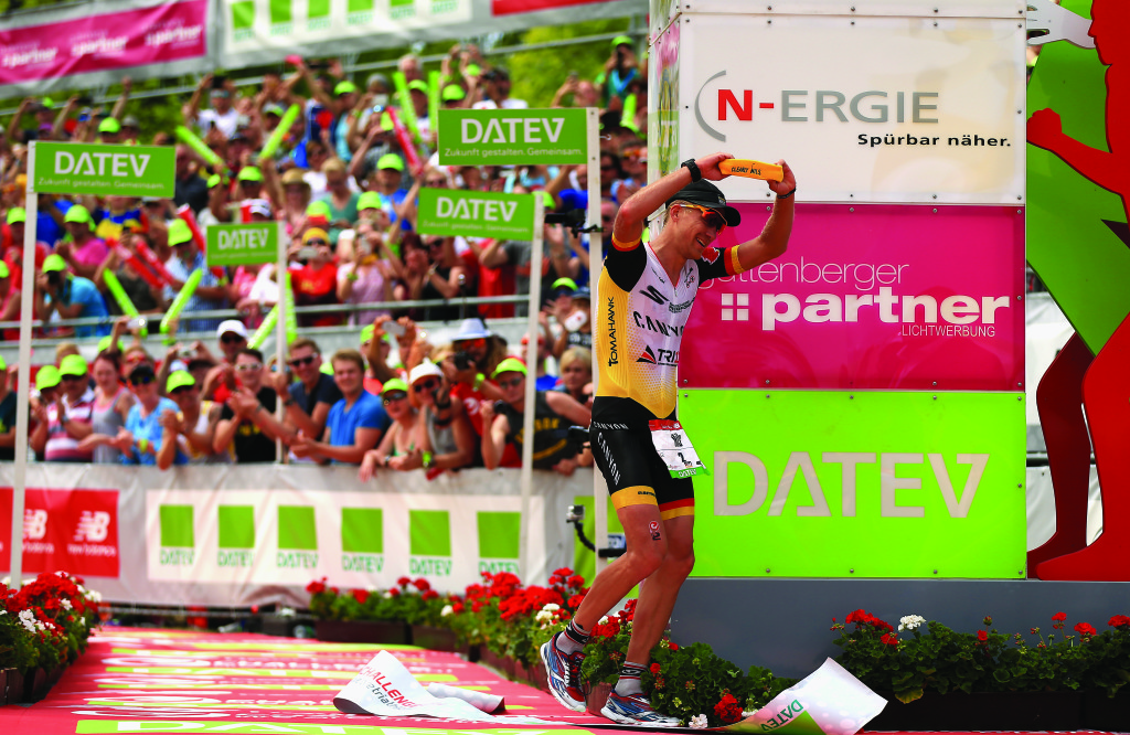 ROTH, GERMANY - JULY 12:  Nils Frommhold of Germany wins the mens race during the Challenge Triathlon Roth on July 12, 2015 in Roth, Germany. (Photo by Stephen Pond/Getty Images for Challenge Triathlon)