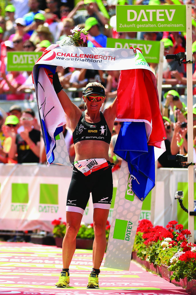 ROTH, GERMANY - JULY 12:  Yvonne van Vlerken of Netherlands celebrates winning the womens race during the Challenge Triathlon Roth on July 12, 2015 in Roth, Germany. (Photo by Stephen Pond/Getty Images for Challenge Triathlon)