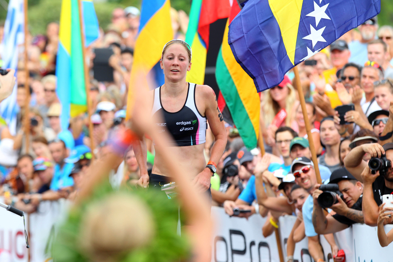 Winner Miranda CARFRAE (AUS) applause 2nd Daniela RYF (SUI) crossing the finishline of the 2014 GoPro Ironman World Championship in Kailua-Kona,HI on October 11, 2014