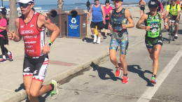 This to me sums up Oceanside 70.3: Steffen passing Jackson back on a crowded beach path. (Photo: Katherine Kelly Lang)